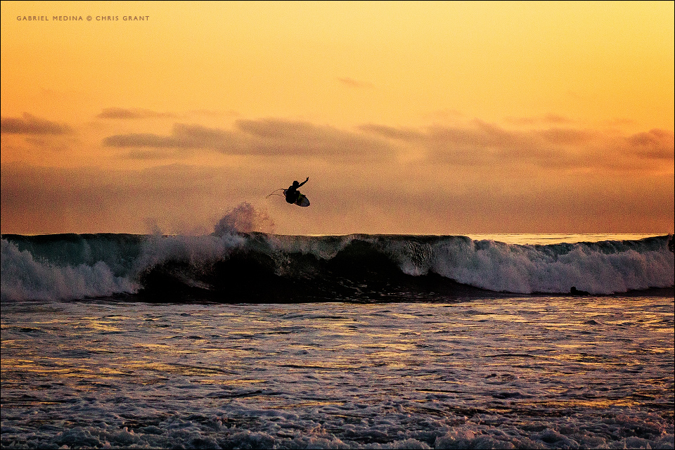 Gabriel Medina launches a big frontside air at sunset. Chris Grant photo on Boardfolio.com